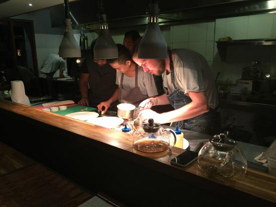 Busy Kitchen busy kitchen, plating the dishes individually - picture of