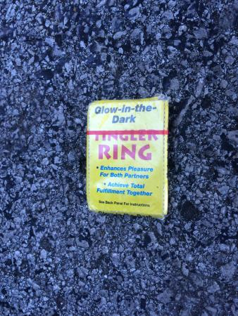 Days Inn & Suites Huntsville: Condom in parking lot outside our room