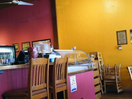 La Cocina de Luz: interior, chip bar around that corner and to the right will  different salsas