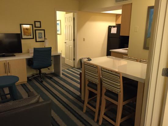 Sonesta ES Suites Malvern : Living area, dining table, kitchen. Main bedroom (king bed) to the immediate right; door to seco