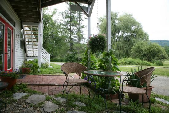 Shaker Meadows Bed and Breakfast: The Patio of the Creamery building on a summer afternoon