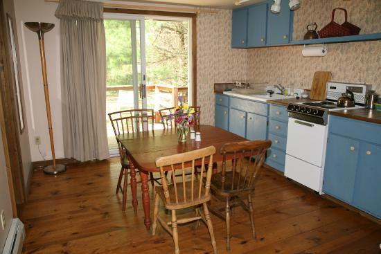 Shaker Meadows Bed and Breakfast: The kitchen of the Spruce Suite looking out to the deck and pines