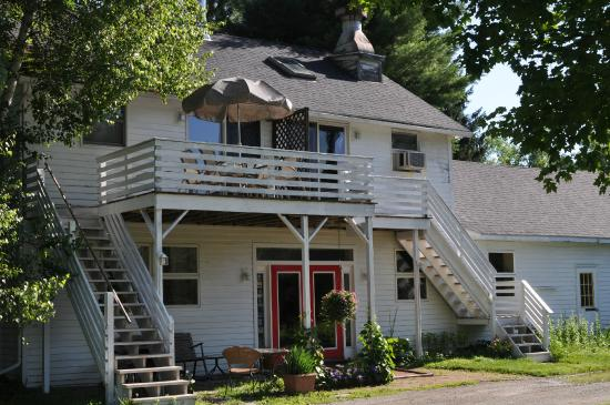 Shaker Meadows Bed and Breakfast: The Creamery Building, red lobby door, and Birch Suite deck