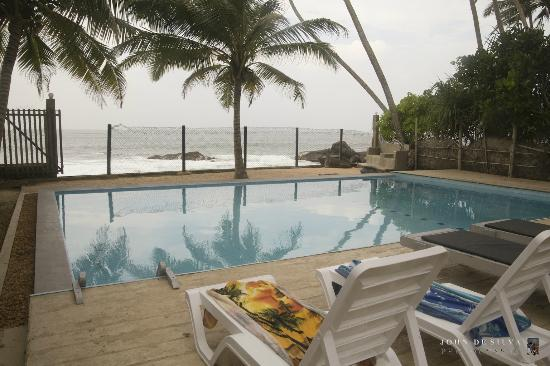 Amor Villa : From grounds looking over pool to beach.