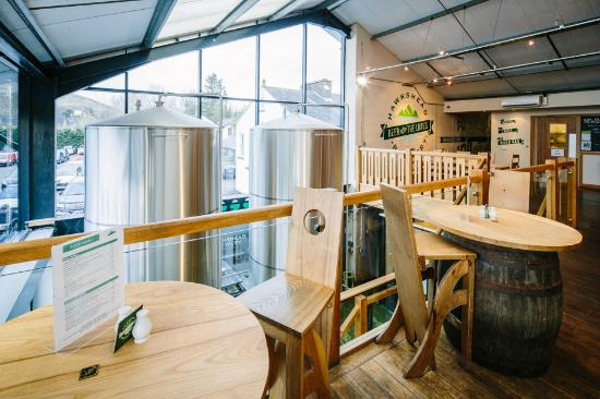 The Beer Hall: Upstairs of the bar area with imposing stainless steel brewing vessels