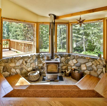 North Cascades Basecamp: wood stove sitting area overlooking ski trail and sledding hill