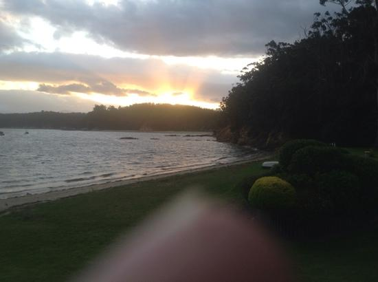 Quarantine Bay Beach Cottages: sunset from patio of beachfront cottage