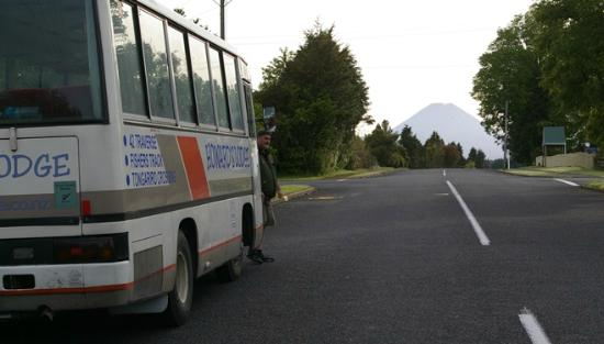Howards Mountain Lodge: Grant with the bus & Mt Ngauruhoe beyond