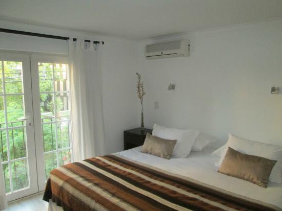 Meridiano Sur, Petit Hotel: Cama de casal quarto 1