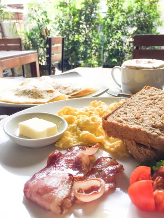 ViaVia: Eggs bacon and toast on front, apple cinnamon pancakes in the back