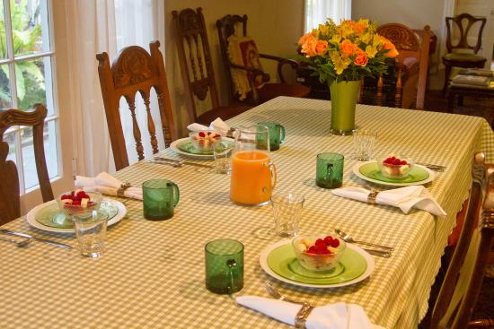 The Inn at 657: The table set for breakfast.  We love coordinating the linens, dishes, and flowers.  Fresh fruit
