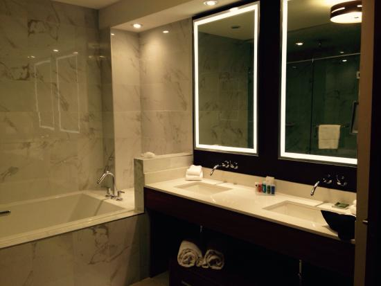 Large clean bathroom with dual sinks and jacuzzi tub - Picture of ...