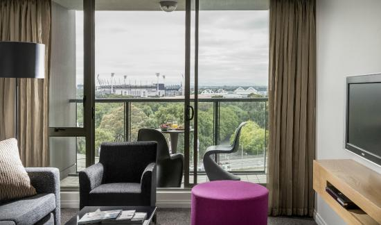 Quay West Suites Melbourne: One bedroom Deluxe Suite easterly aspect, view of MCG and Rod Laver Arena