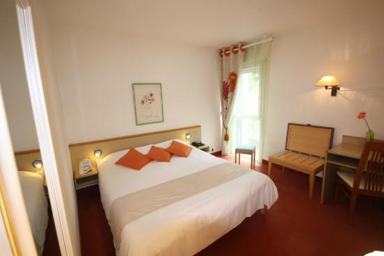 Hôtel Le Branhoc Logis Brit Hotel : Chambre vue parc
