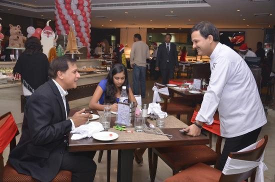 Chef ajay mathur interacting with the guests picture of for Ajays catering cuisine
