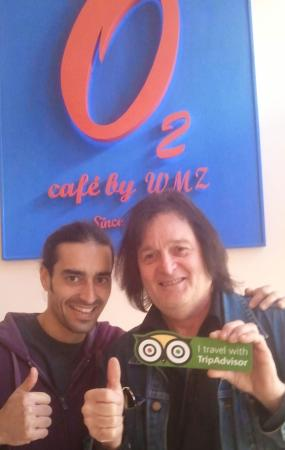 Café O2: One of the3 brothers who own O2 pictured with Trip Advisor fruitcake Ric Herrington!