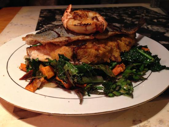 One World Cafe : One of Chef Adam's nightly specials- crab stuffed trout with sauteed kale and roasted sweet pota