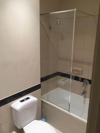 Ensuite Bathroom And Shower ensuite bathroom - shower over bath. room 204. - picture of