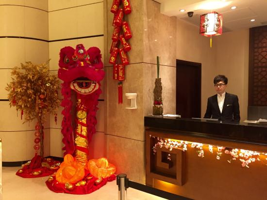 royal view hotel reception desk they have a nice decorations for the upcoming chinese new - Orange Hotel Decoration