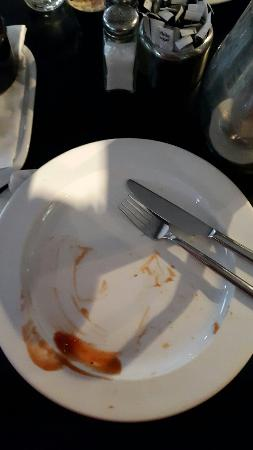 Amicus Restaurant: This is how good the beef burger is at Amicus. Not a bit left