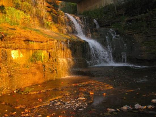 Finger Lakes Waterfall Resort: the hotel's private waterfall at sunset
