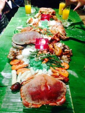 Taunton, UK: boodle fight meal. Meat, Seafood & veg's salad