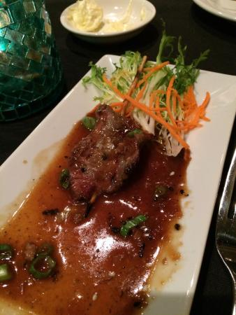 The Grist Mill and One Up Bar: Grilled beef satay- amazing!! (Came with four and we already ate 3)