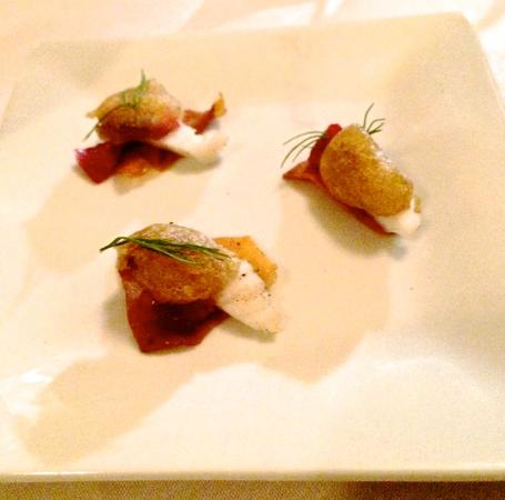Five Fifty Five: Amuse of (I think) roasted grape, monkfish on a parsnip chip.