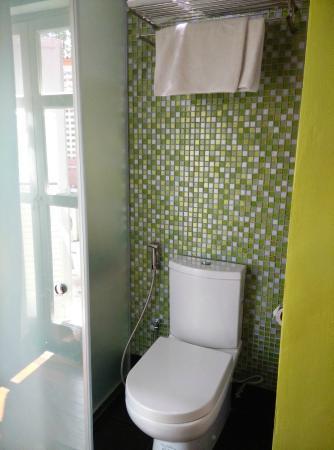 Toilet with sliding door in Deluxe Room - Picture of Keong Saik ...