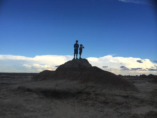 Badlands/ White River KOA: The kids loved climbing and watching the distant storm clouds roll in.