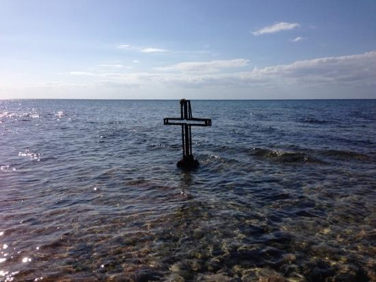 Ernesto's Rental: Cross in water, try and find it.