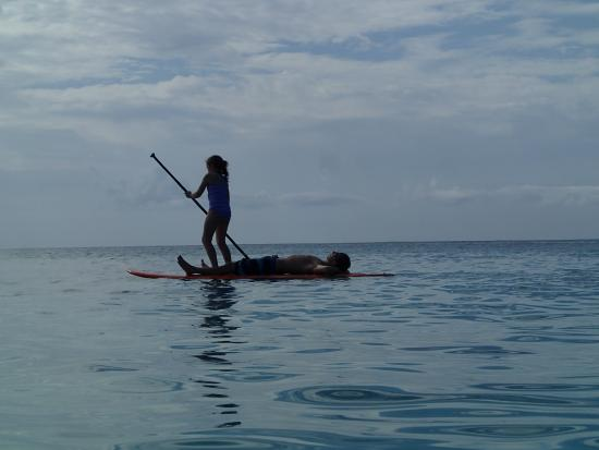 Cayman Stand Up Paddle Co: The Kids enjoying the paddle board on 7 Mile Beach