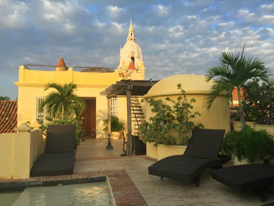 Casa Pombo : Rooftop pool, terrace, and view of the cathedral across the street