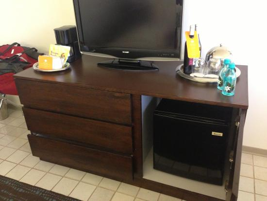 tv on chest of drawers and cupboard on the right with mini fridge picture of waikiki parc. Black Bedroom Furniture Sets. Home Design Ideas