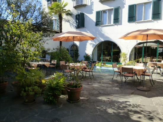 Hotel Arcadia: Restaurant und Garten