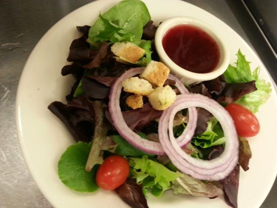 Mr V's Family Restaurant: House Salad pictured with Huckleberry Vinaigrette Dressing