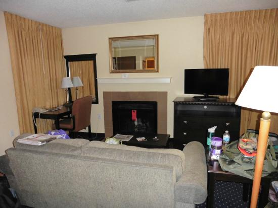 Hawthorn Suites by Wyndham Fort Wayne: desk, sofa, and wood-burning fireplace