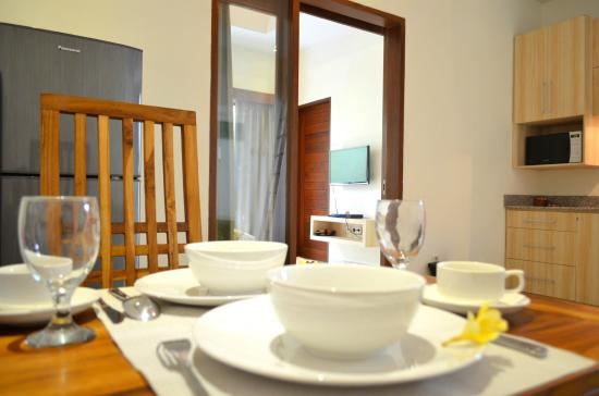 The Jas Villas: One Bedroom - Dining Area and Kitchen