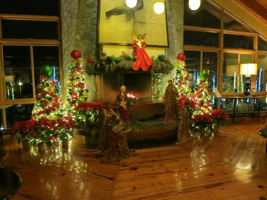 the forest lodge at camp john hay fireplace with decor in the lobby