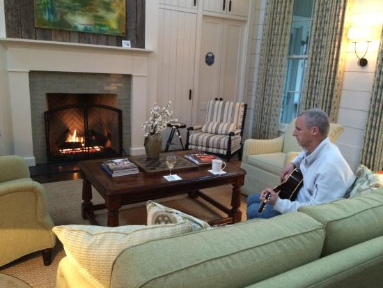 Main room with guitar for guests to play next to the roaring fire