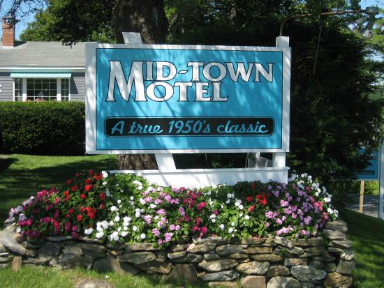 Mid-Town Motel: Motel Sign And Flowers