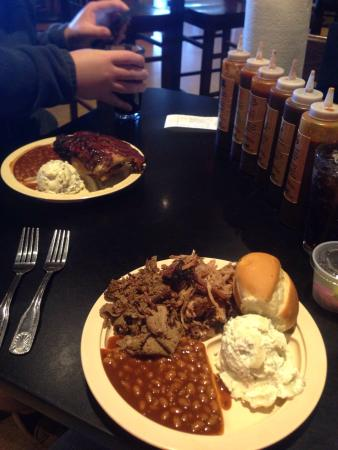 Whole Hog Cafe: Lunch. Pulled pork and beef brisket combo and then a half rack plate in the back. Yum!