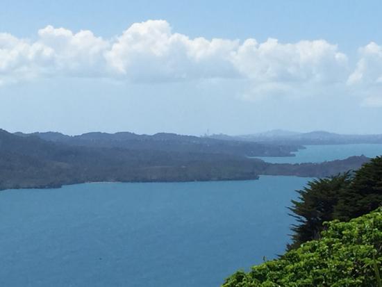Manukau Heads Lighthouse: The mountain, the sea, and sky tower