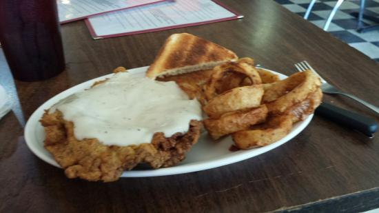 Walker's Cafe: The chicken fried steak and onion rings are fixed and dredged in seasoned flour when you place y