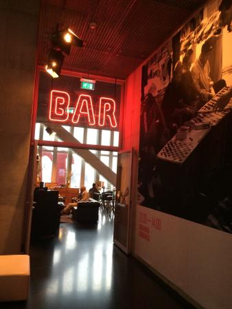 Nhow Bar: Entrance of the bar.... Don't miss the virtual fireplace at the left !!!