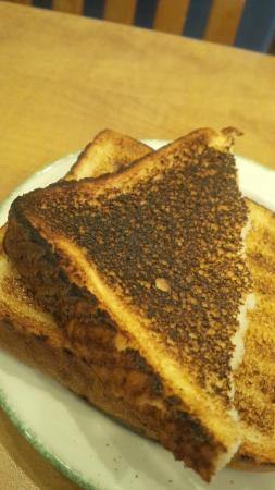 Cora Restaurant: Well cooked toast...very well cooked...