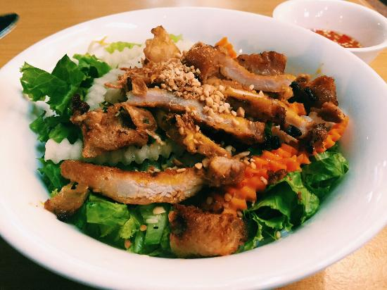 Saigon Vietnamese Delicacy: Grilled pork strips and fried springrolls on a bed of dry Vietnamese vermicelli  noodles and veg