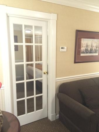 Comfort Inn & Suites: Doorway into bedroom with king-sized bed