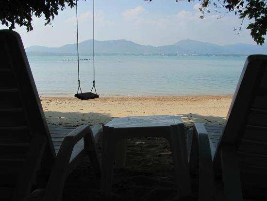 Baan Mai Cottages: Each beach bungalow has sun chairs, a swing, and a hammock