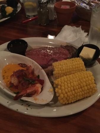 Steamers Restaurant & Raw Bar: Prime Rib with bacon-wrapped, crab-stuffed jumbo shrimp and corn on the cob. Good stuff!